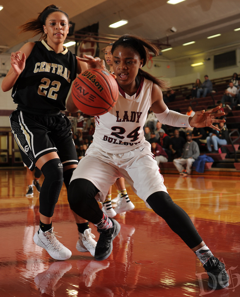 NWA Democrat-Gazette/ANDY SHUPE<br /> Chasidee Owens (24) of Springdale collects a loose ball in the lane in front of Kiara Williams (22) of Little Rock Central Tuesday, Nov. 24, 2015, at Bulldog Gymnasium in Springdale. Visit nwadg.com/phtoos to see more photographs from the game.