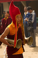 Buddhist monks playing uniue Sikkimese musical instruments during the Losar New Year ceremonial procession at a monastery in the Himalayan foothills of Sikkim, India
