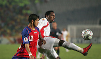United Arab Emirates' Ahmed Khalil (11) takes the ball away from Costa Rica's Cristian Gamboa (12) during the FIFA Under 20 World Cup Quarter-final match at the Cairo International Stadium in Cairo, Egypt, on October 10, 2009. Costa Rica won the match 1-2 in overtime play.