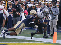 Annapolis, MD - October 21, 2017: Navy Midshipmen linebacker D.J. Palmore (45)  pushes UCF Knights running back Adrian Killins Jr. (9) out of bounds during the game between UCF and Navy at  Navy-Marine Corps Memorial Stadium in Annapolis, MD.   (Photo by Elliott Brown/Media Images International)