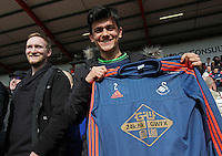 A Swansea fan poses with Jordi Amat of Swansea City's training shirt before the Barclays Premier League match between AFC Bournemouth and Swansea City played at The Vitality Stadium, Bournemouth on March 11th 2016