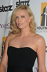 BEVERLY HILLS, CA. - October 26: Charlize Theron arrives at the 13th annual Hollywood Awards Gala Ceremony held at The Beverly Hilton Hotel on October 26, 2009 in Beverly Hills, California.