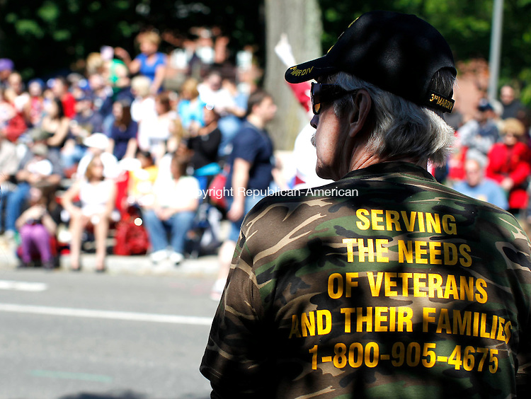 Naugatuck, CT- 27 May 2013-052713CM12-  Rob Scriver, of Naugatuck and a U.S. Marine Corps Vietnam Veteran watches as the parade goes up Church Street during the annual Memorial Day Parade in downtown Naugatuck Monday morning.    Christopher Massa Republican-American