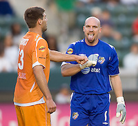 Puerto Rico Islanders goalkeeper Bill Gaudette (1) is congratulated by teammate David Horst (13) after making a save. The Puerto Rico Islanders defeated the LA Galaxy 4-1 during CONCACAF Champions League group play at Home Depot Center stadium in Carson, California on Tuesday July 27, 2010.