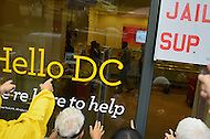 October 13, 2011  (Washington, DC)  Members of the group October2011 taunt people inside of a Wells Fargo Bank branch in downtown Washington.  At one point, protesters went inside the bank. Police removed the protesters with no arrests, but the branch closed while protesters remained outside.   (Photo by Don Baxter/Media Images International)