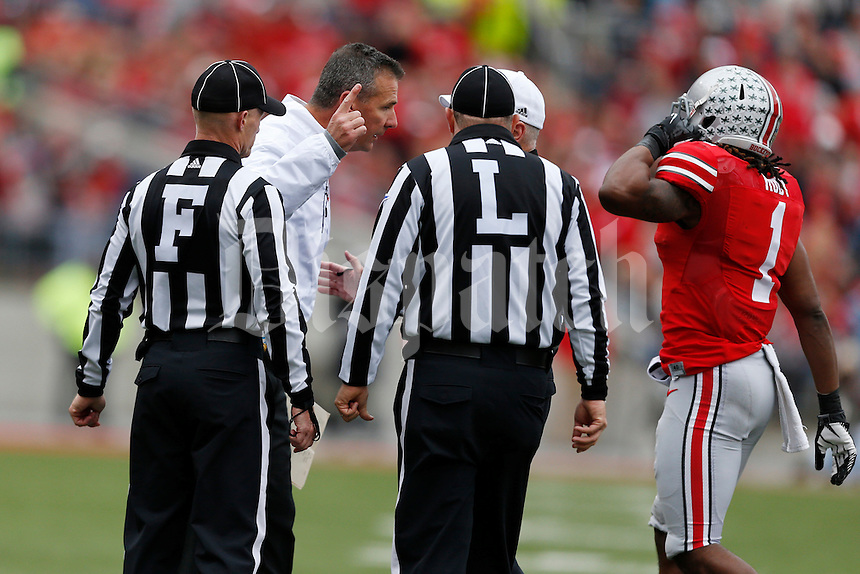 Urban Meyer argues Bradley Roby's ejection.    Eamon Queeney/Dispatch    During the NCAA football game at Ohio Stadium in Columbus, Ohio on Oct. 19, 2013. (Columbus Dispatch photo by     )