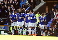 Pictured: Lacina Traore of Everton (TOP) celebrating his opening goal with team mates. Sunday 16 February 2014<br /> Re: FA Cup, Everton v Swansea City FC at Goodison Park, Liverpool, UK.