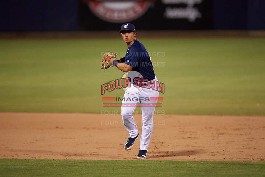 AZL Brewers Blue shortstop Danny Casals (10) throws to first base during an Arizona League game against the AZL Rangers on July 11, 2019 at American Family Fields of Phoenix in Phoenix, Arizona. The AZL Rangers defeated the AZL Brewers Blue 5-2. (Zachary Lucy/Four Seam Images)