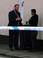 Pictured: A police officers in civilian clothes speaks to a man inside the cordon at Jeffrey Street, Newport, south Wales, UK. Wednesday 20 September 2017<br /> Re: Two men have been arrested in south Wales over Friday's terror attack on a London Underground train, bringing the total number held to five.<br /> Two men, one 48 and the other 30 were detained under the Terrorism Act in the early hours, after a search at an address in Newport.<br /> Police are still searching there, and at a second address in Newport.<br /> Thirty people were injured when a homemade bomb partially exploded on a rush-hour Tube train at Parsons Green in south-west London.