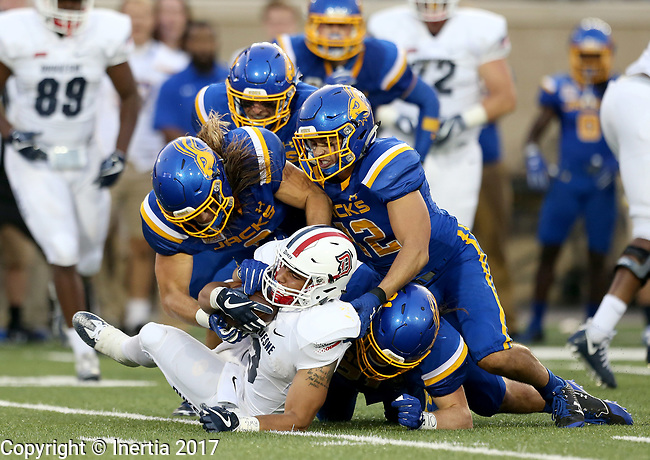BROOKINGS, SD - AUGUST 31: PJ Fulmore #3 from Duquesne is brought down by a host of defenders from South Dakota State University in the first half of their game Thursday night at Dana J. Dykhouse Stadium in Brookings. (Photo by Dave Eggen/Inertia)
