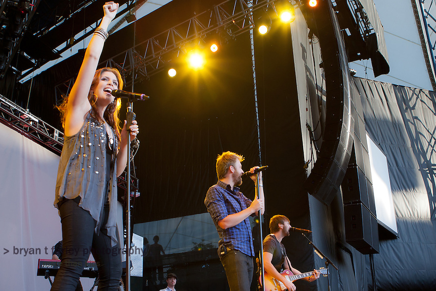 Lady Antebellum performs at the Shoreline Amphitheater in Mountain View, California during their 2010 Need You Now Tour. Charles Kelley, Dave Haywood, and Hillary Scott won five Grammy's for their 2010 album.