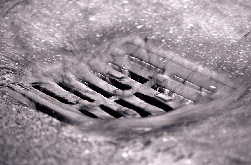 Storm drain in rainstorm.