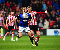 Lincoln City's Michael O'Connor vies for possession with  Crewe Alexandra's James Jones<br /> <br /> Photographer Andrew Vaughan/CameraSport<br /> <br /> The EFL Sky Bet League Two - Lincoln City v Crewe Alexandra - Saturday 6th October 2018 - Sincil Bank - Lincoln<br /> <br /> World Copyright &copy; 2018 CameraSport. All rights reserved. 43 Linden Ave. Countesthorpe. Leicester. England. LE8 5PG - Tel: +44 (0) 116 277 4147 - admin@camerasport.com - www.camerasport.com