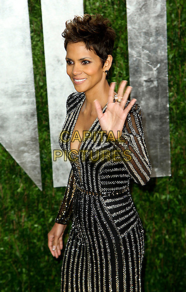 Halle Berry.2013 Vanity Fair Oscar Party following the 85th Academy Awards held at the Sunset Tower Hotel, West Hollywood, California, USA..February 24th, 2013.oscars half length black gold silver striped stripes dress sequins sequined cleavage hand arm palm waving .CAP/ADM/SLP/DOW.©Dowling/StarlitePics/AdMedia/Capital Pictures