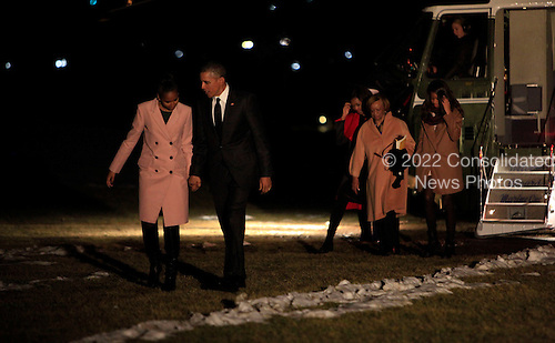 United States President Barack Obama with daughters Sasha and Malia, Marian Robinson and First Lady Michelle Obama walk from Marine One to enter the White House following a trip to Selma, Alabama on March 7, 2015.<br /> Credit: Dennis Brack / Pool via CNP