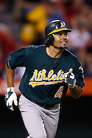 Coco Crisp #4 of the Oakland Athletics runs to first base against the Los Angeles Angels at Angel Stadium on September 10, 2012 in Anaheim, California. Oakland defeated Los Angeles 3-1. (Larry Goren/Four Seam Images)