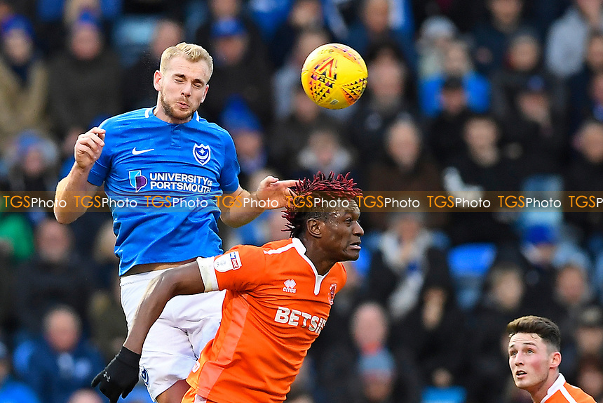 Jack Whatmough of Portsmouth left wins a header during Portsmouth vs Blackpool, Sky Bet EFL League 1 Football at Fratton Park on 12th January 2019