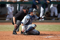 Home plate umpire Reid Churchill stands behind Xavier Musketeers catcher Nate Soria (5) during the game against the Penn State Nittany Lions at Coleman Field at the USA Baseball National Training Center on February 25, 2017 in Cary, North Carolina. The Musketeers defeated the Nittany Lions 10-4 in game one of a double header. (Brian Westerholt/Four Seam Images)