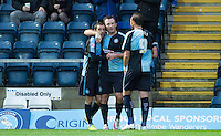 Garry Thompson of Wycombe Wanderers congratulates fellow goal scorer Michael Harriman of Wycombe Wanderers during the Sky Bet League 2 match between Wycombe Wanderers and Portsmouth at Adams Park, High Wycombe, England on 28 November 2015. Photo by Andy Rowland.