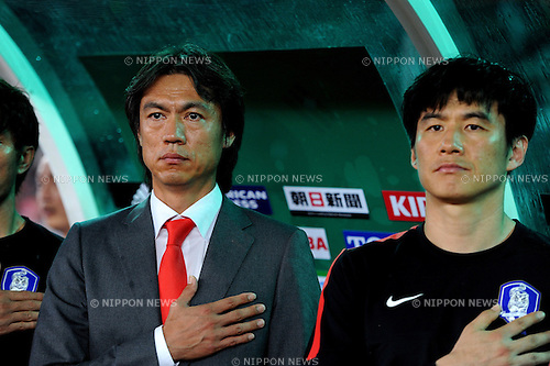 Hong Myung-Bo,  Park Kun-Ha (KOR),<br /> JULY 28, 2013 - Football / Soccer :<br /> South Korea head coach Hong Myung-Bo and coach Park Kun-Ha listen to the national anthem before the EAFF East Asian Cup 2013 match between South Korea 1-2 Japan at Jamsil Olympic Stadium in Seoul, South Korea. (Photo by FAR EAST PRESS/AFLO)