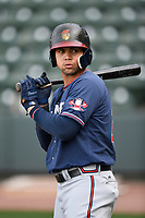 Left fielder Jefry Ramos (22) of the Rome Braves takes batting practice before a game against the Greenville Drive on Saturday, April 14, 2018, at Fluor Field at the West End in Greenville, South Carolina. Rome won, 4-0. (Tom Priddy/Four Seam Images)