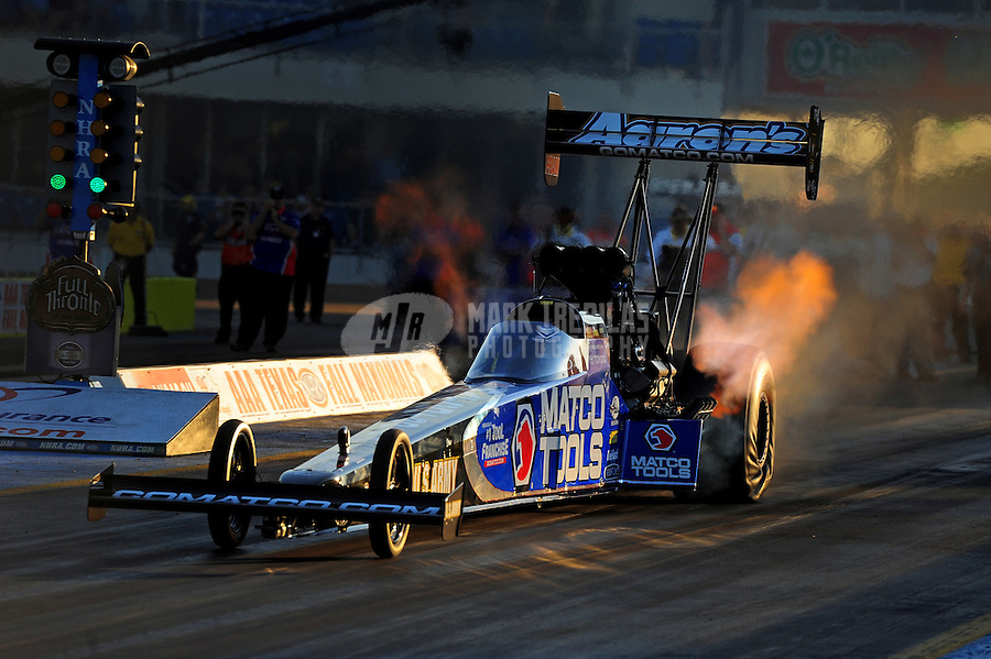 Sept. 18, 2011; Ennis, TX, USA: NHRA top fuel dragster driver Antron Brown during qualifying for the Fall Nationals at the Texas Motorplex. Mandatory Credit: Mark J. Rebilas-