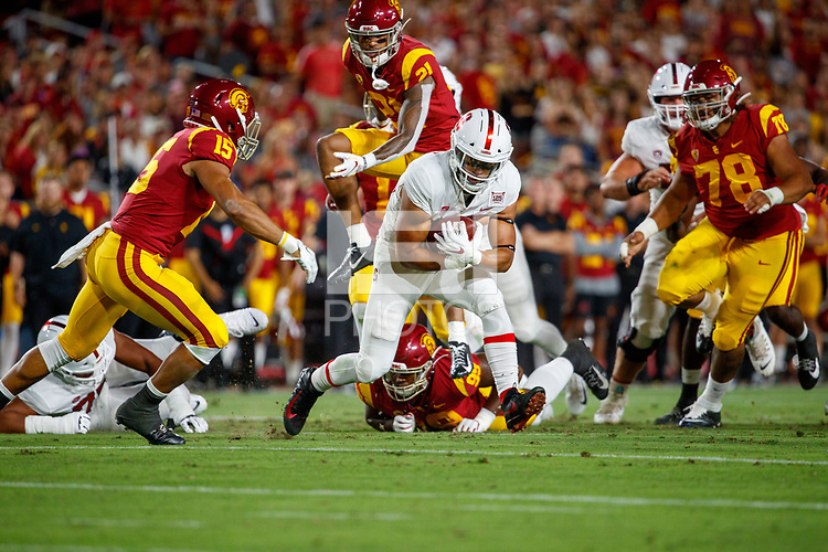 LOS ANGELES, CA - SEPTEMBER 7: Stanford Cardinal Cameron Scarlett #22 runs with the ball during a game between USC and Stanford Football at Los Angeles Memorial Coliseum on September 7, 2019 in Los Angeles, California.