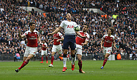 Tottenham Hotspur's Harry Kane gets to the ball before Arsenal's Sokratis Papastathopoulos and Laurent Koscielny<br /> <br /> Photographer Rob Newell/CameraSport<br /> <br /> The Premier League - Tottenham Hotspur v Arsenal - Saturday 2nd March 2019 - Wembley Stadium - London<br /> <br /> World Copyright © 2019 CameraSport. All rights reserved. 43 Linden Ave. Countesthorpe. Leicester. England. LE8 5PG - Tel: +44 (0) 116 277 4147 - admin@camerasport.com - www.camerasport.com