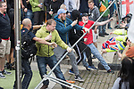 "© Joel Goodman - 07973 332324 . 11/06/2017 . Manchester , UK . Demonstrators tear down barriers designed to contain the demonstration . Demonstration against Islamic hate , organised by former EDL leader Tommy Robinson's "" UK Against Hate "" and opposed by a counter demonstration of anti-fascist groups . UK Against Hate say their silent march from Piccadilly Train Station to a rally in Piccadilly Gardens in central Manchester is in response to a terrorist attack at an Ariana Grande concert in Manchester , and is on the anniversary of the gun massacre at the Pulse nightclub in Orlando . Photo credit : Joel Goodman"