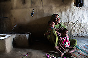 Aisha Khatoon plays with her grand daughter, Muniya (left) in their hut in Shivpur Hariyya village in Raxaul district of Bihar. Muniya's mother Ravina Khatoon died few days after giving birth to Muniya.
