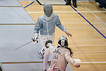 12 February 2017: Duke's Lindsay Sapienza (above) and Boston College's Gabrielle Chau (below) during Saber. The Duke University Blue Devils hosted the Boston College Eagles at Card Gym in Durham, North Carolina in a 2017 College Women's Fencing match. Duke won the dual match 19-8 overall, 6-3 Foil, 5-4 Epee, and 8-1 Saber.