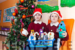 Sisters Kate and Evie Horgan from Scoil Ísogáin, Ballybunion were delighted to bring in figures for the school crib, which were hand knitted by their nan Brenda Jones from Manchester.