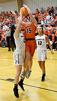 Westside Eagle Observer/MIKE ECKELS<br /> <br /> As Lady Lion Shylee Morrison (15) goes up for a jumper, Lady Pioneer Ariel Nix (13) tipped the ball enough for Morrison to lose her grip during the third quarter of the Gravette-Gentry conference game at the competition gym in Gravette Jan. 7.