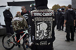 "A counter-demonstrator with a leather jacket with the motif ""total chaos"" on it pictured during a demonstration by the Alternative für Deutschland (AfD) political party in Berlin. Around 5000 supporters of the AfD took part in the march and rally through central Berlin calling on German Chancellor Angela Merkel to halt the influx of refugees into the country. Around one million refugees from the Middle East and north Africa arrived in Germany during 2015, 50,000 of whom came to Berlin."