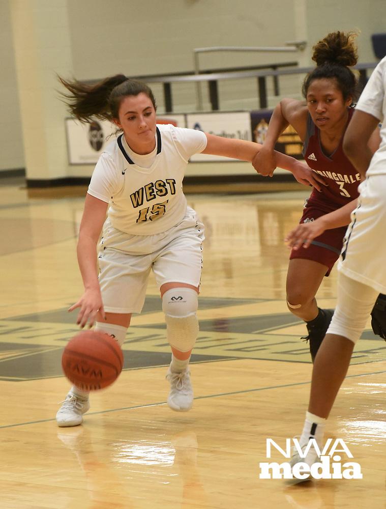 NWA Democrat-Gazette/FLIP PUTTHOFF <br /> Anna Kash (15) moves toward the basket Tuesday Jan. 8 2019 for Bentonville West.