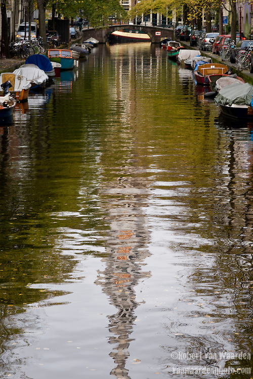 The canal along the Groeneburgwal in Amsterdam, the Netherlands, with the Zuiderkerk reflected in the water.