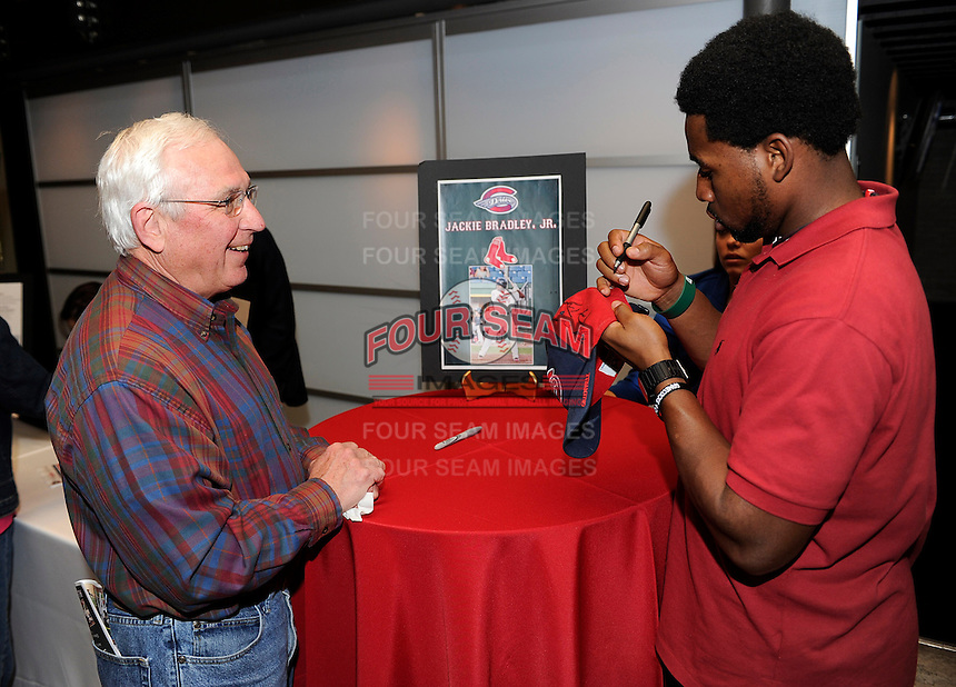 Boston Red Sox prospect outfielder Jackie Bradley Jr. signs autographs and talks with fans of the Greenville Drive at the team's annual Hot Stove Event on Tuesday, January 29, 2013, in Greenville, South Carolina. Bradley is ranked No. 32 prospect in the country for the 2013 season by MLB.com. (Tom Priddy/Four Seam Images)