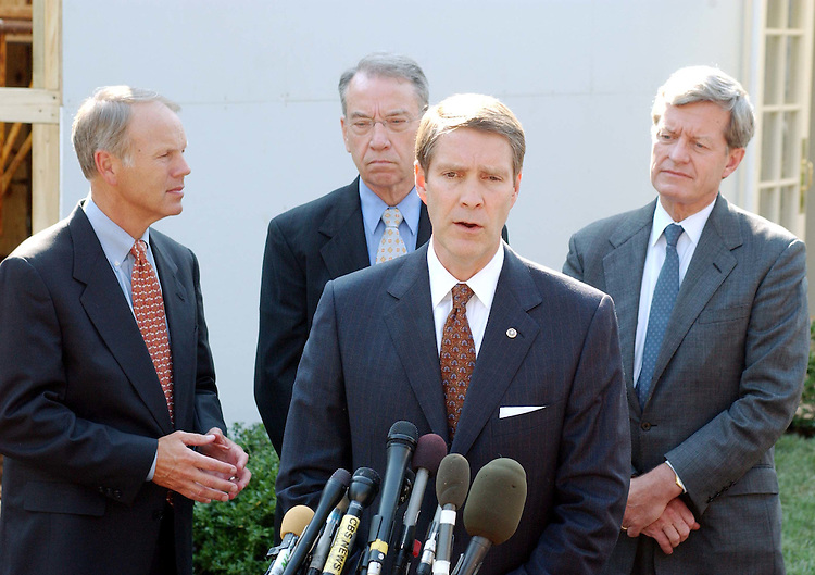 9/25/03.MEDICARE PRESCRIPTION DRUG BILL/MEETING AT WHITE HOUSE--Sen. Don Nickles, R-Okla., Senate Finance Chairman Charles E. Grassley, R-Iowa, Senate Majority Leader Bill Frist, R-Tenn., and Senate Finance ranking .Democrat Max Baucus, D-Mont., talk to media after a mid-afternoon meeting of Medicare conferees with President Bush on the Medicare prescription drug bill, HR 1. .CONGRESSIONAL QUARTERLY PHOTO BY SCOTT J. FERRELL