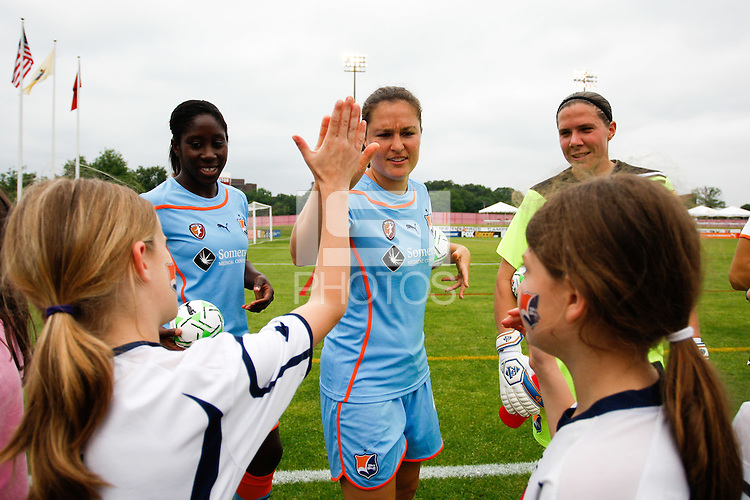 Kendall Fletcher (4) of Sky Blue FC high fives a young supporter. Sky Blue FC and the Boston Breakers played to a 0-0 tie during a Women's Professional Soccer (WPS) match at Yurcak Field in Piscataway, NJ, on June 12, 2011.