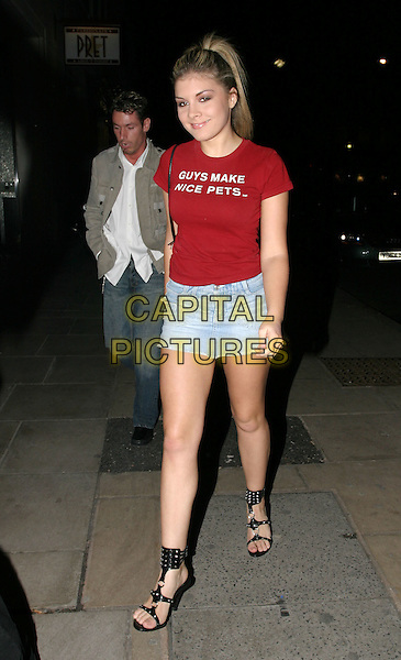 DEAN GAFFNEY (BACKGROUND).Playboy DVD launch party at Ruby Lo .25 February 2004.full length, full-length, slogan t-shirt, denim skirt, black strappy sandals, funny.www.capitalpictures.com.sales@capitalpictures.com.© Capital Pictures.