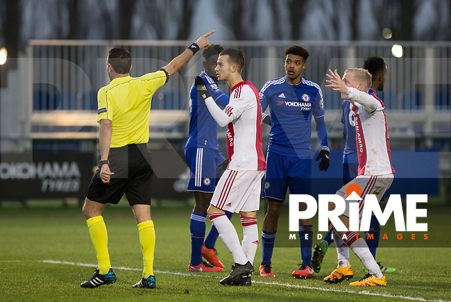 Ajax players cannot believe there late goal is disallowed and surround the referee during the UEFA Youth League Quarter Final match between Chelsea U19 and Ajax U19 at Chelsea Training Ground, Cobham, England on 15 March 2016. Photo by Andy Rowland / PRiME Media Images.