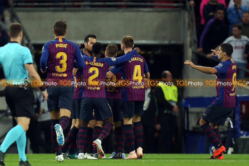 Philippe Coutinho of FC Barcelona is congratulated after scoring the first goal during Tottenham Hotspur vs FC Barcelona, UEFA Champions League Football at Wembley Stadium on 3rd October 2018