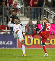 13 April 2011: Los Angeles Galaxy forward Juan Pablo Angel #9 and Toronto FC midfielder Gianluca Zavarise #28 in action during an MLS game between Los Angeles Galaxy and the Toronto FC at BMO Field in Toronto, Ontario Canada..The game ended in a 0-0 draw.