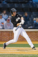 Matt Conway (25) of the Wake Forest Demon Deacons makes contact with the baseball against the North Carolina Tar Heels at Wake Forest Baseball Park on March 9, 2013 in Winston-Salem, North Carolina.  The Tar Heels defeated the Demon Deacons 20-6.  (Brian Westerholt/Four Seam Images)