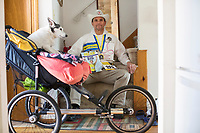 Carlos Arredondo, 57, is seen in his home in Roslindale, Boston, Massachusetts, USA, on Sat., March 31, 2018. Arredondo is well known as the &quot;man in the cowboy hat&quot; who helped out in the aftermath of the Boston Marathon Bombing in 2013. Carlos is wearing a jacket that he has used to create a t-shirt design for when he runs the Boston Marathon later this year. Though he has run the race unofficially previously, this will be the first time he runs it &quot;legally,&quot; he says.<br /> <br /> Carlos' dog, Buddy, age 18, can be seen in a cart that Carlos uses while training for the marathon to take his dog with him. <br /> <br /> Carlos says he often accidentally calls Buddy by his son's name, Brian. Brian Arredondo died by suicide in 2011 after a battle with depression following the 2004 death of Arrendondo's other son  Marine Lance Corporal Alexander Scott Arredondo, who was killed while serving in Iraq.