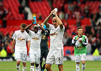 Pictured: Jonjo Shelvey of Swansea thanks supporters after the final whistle. Saturday 16 August 2014<br /> Re: Premier League Manchester United v Swansea City FC at the Old Trafford, Manchester, UK.