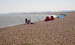 People sea fishing from beach, Hollesley Bay, Shingle Street, Suffolk, England