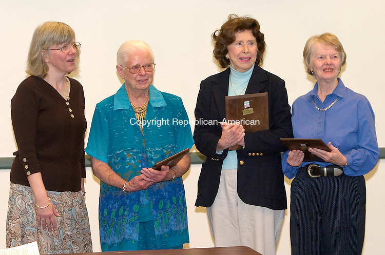 SOUTHBURY, CT. 11 May 2010-051110SV01--From left, Shirley Thorson, head librarian, honors Mary Alice Dressel, Kathleen Kelleher, and Margaret Deutchman with the Francis Voss Award for volunteering at the library at the annual Volunteer Appreciation Luncheon sponsored by the Friends of the Southbury Library in Southbury Tuesday. <br /> Steven Valenti Republican-American