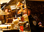 A security officer buys a coffee, in the second floor of the Trump Tower, while United States President-elect Donald Trump is holds meetings on top floors of the building, November 21, 2016, in New York, New York.<br /> Credit: Aude Guerrucci / Pool via CNP
