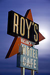 The moon rises behind the historic Roy's Motel and Cafe sign, a landmark located along historic Route 66 at Amboy, California
